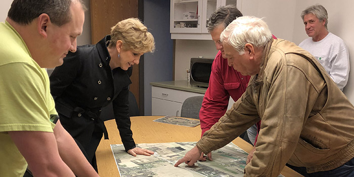 County Executive reviews maps with Fairview and Girard supervisors