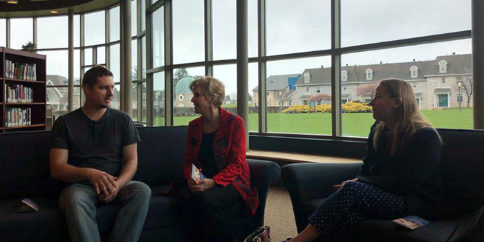 People speak inside Ridge Library at Mercyhurst North East