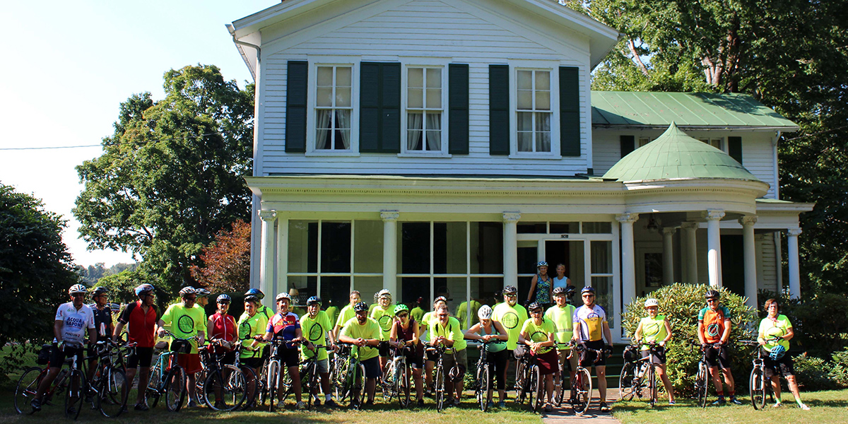 Group of bicycle riders outside Battles Museums of Rural Life in Girard