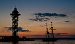 Erie's Bicentennial Tower and U.S. Brig Niagara on Presque Isle Bay at sunset
