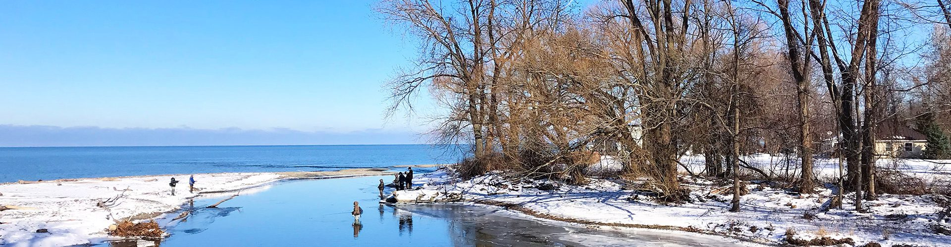 Anglers fish along snowy lake shore in Erie County